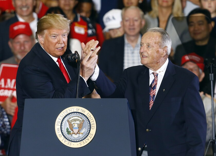At a 2018 rally, President Trump points to Bobby Bowden's national championship ring.