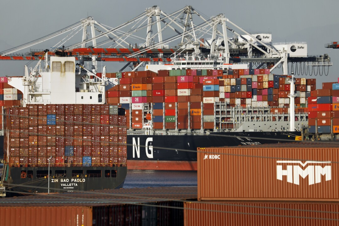 Container ships docked at the Ports of Los Angeles wait to be unload on Wednesday.