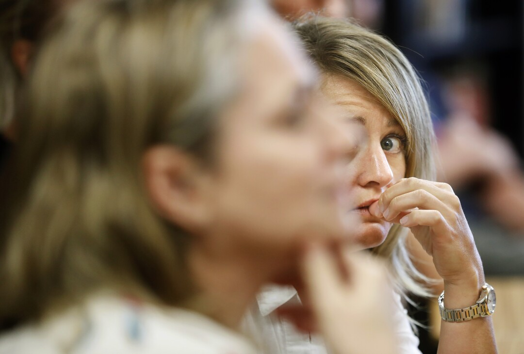 Miranda Domenico, right, listens closely during an active shooter training session held at Golden View Classical Academy, a charter school in Golden, Colo.