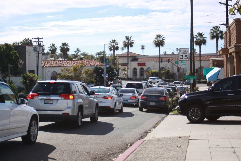 Proponents of keeping the parking on Torrey Pines Road between Girard and Prospect argue that trucks and other cars slow down when approaching parked cars.