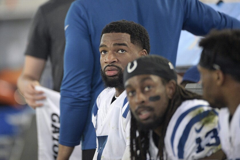 FILE - Indianapolis Colts quarterback Jacoby Brissett (7) and wide receiver T.Y. Hilton (13) watch from the bench during the second half of an NFL football game against the Jacksonville Jaguars in Jacksonville, Fla., in this Sunday, Dec. 29, 2019, file photo.By joining the Dolphins, Brissett embraced a No. 2 role behind Tua Tagovailoa, who is being groomed as a potential franchise quarterback — unless Houston's Deshaun Watson goes on the trade block, and Miami pursues him. Either way, Brissett will likely be on the bench at age 28. (AP Photo/Phelan M. Ebenhack, File)