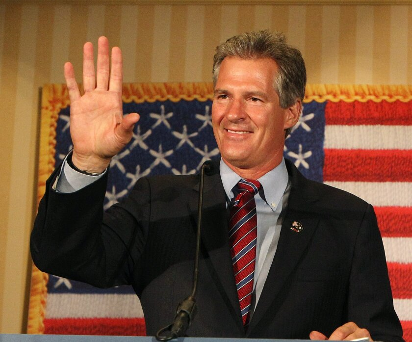 Scott Brown, a former U.S. Senator from Massachusetts, waves to supporters after winning New Hampshire's Republican U.S. Senate primary on Tuesday Sept. 9, 2014 in Concord, N.H. Brown will face incumbent Democrat Jeanne Shaheen in the general election in November. (AP Photo/Jim Cole)