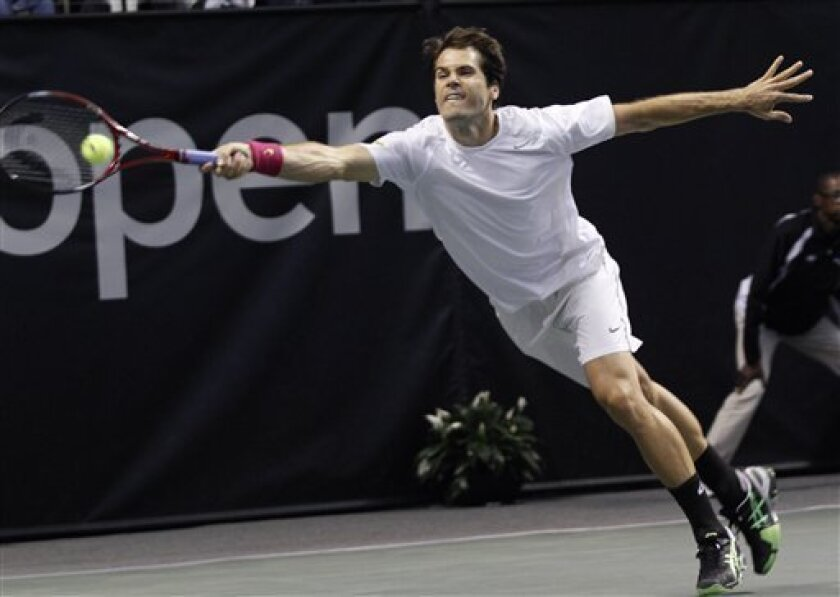 Tommy Haas reaches for a forehand during a semifinal match against John Isner at the SAP Open tennis tournament in San Jose, Calif., Saturday, Feb. 16, 2013. Haas defeated Isner 6-3,6-4. (AP Photo/George Nikitin)