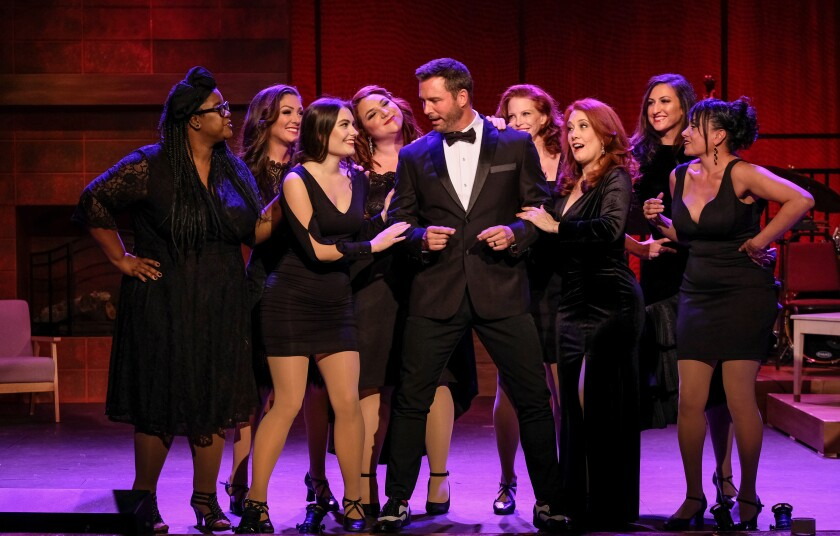 "Eric Martsolf surrounded by cast members in ""Welkome Home for the Holidays"" at the Welk Resort Theatre in Escondido."
