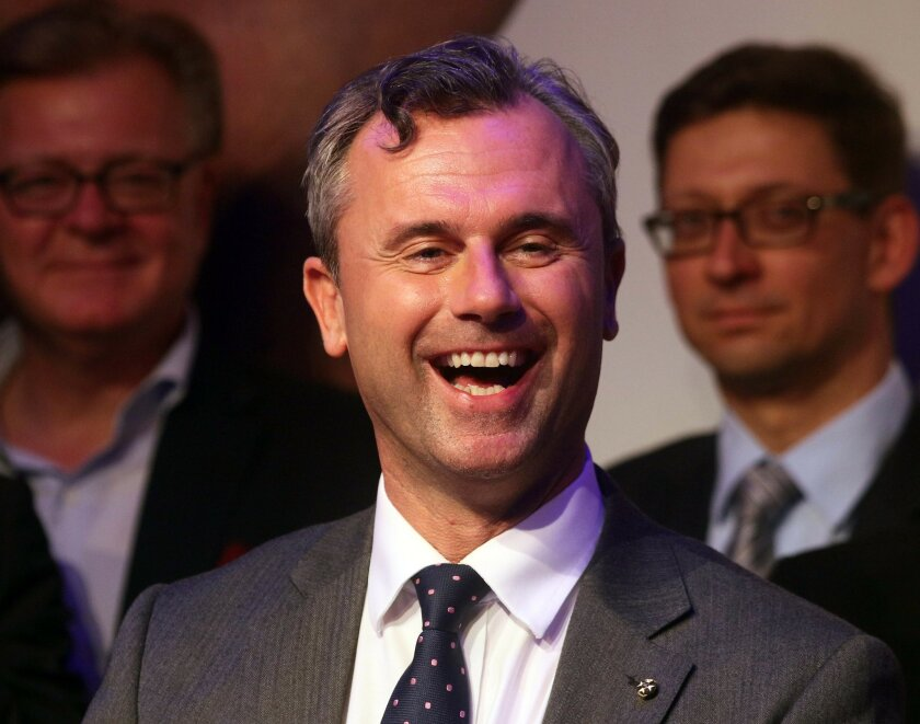 FILE - In this May 22, 2016 file picture Norbert Hofer candidate for Austria's Presidency for Austria's Freedom Party, FPOE, smiles in Vienna, Austria.  Austria's highest court ruled Friday July 1, 2016  that presidential elections narrowly lost by  right-wing candidate  Hofer must be repeated afte
