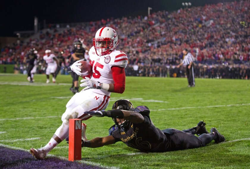 Nebraska's receiver De'Mornay Pierson-El steps out just before with pylon with 4:41 left in the third quarter.  The Nebraska Cornhuskers played the Northwestern Wildcats in a football game on Saturday, Oct. 18, 2014, in Evanston, Ill. (AP Photo/The World-Herald, Ryan Soderlin)