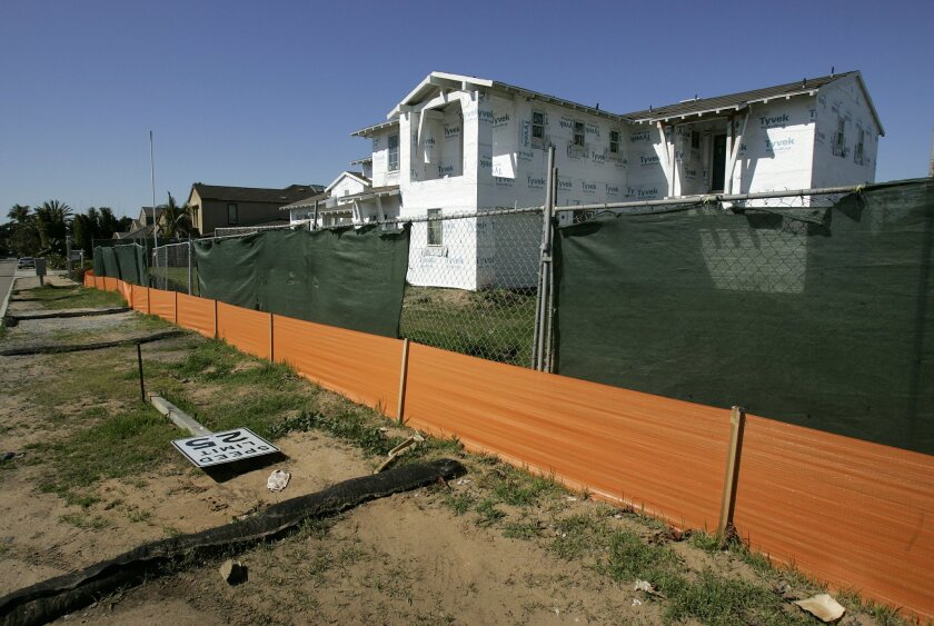 Homes in La Costa stood unfinished in February after the project was foreclosed upon. The builder, Barratt American, is going out of business.