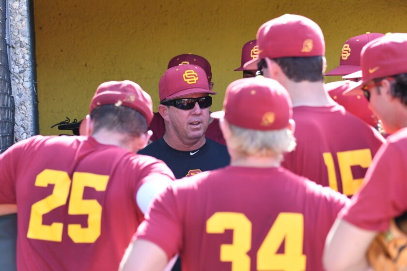 USC baseball coach Jason Gill talks to his players during a practice on the campus of USC.