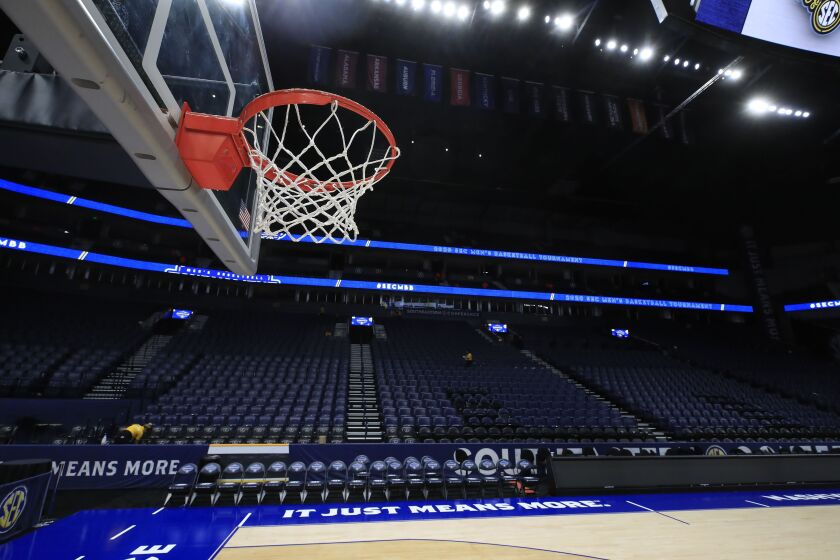 The basket and the arena sit unused after the announcement of the cancellation of the SEC tournament on Thursday in Nashville, Tenn.