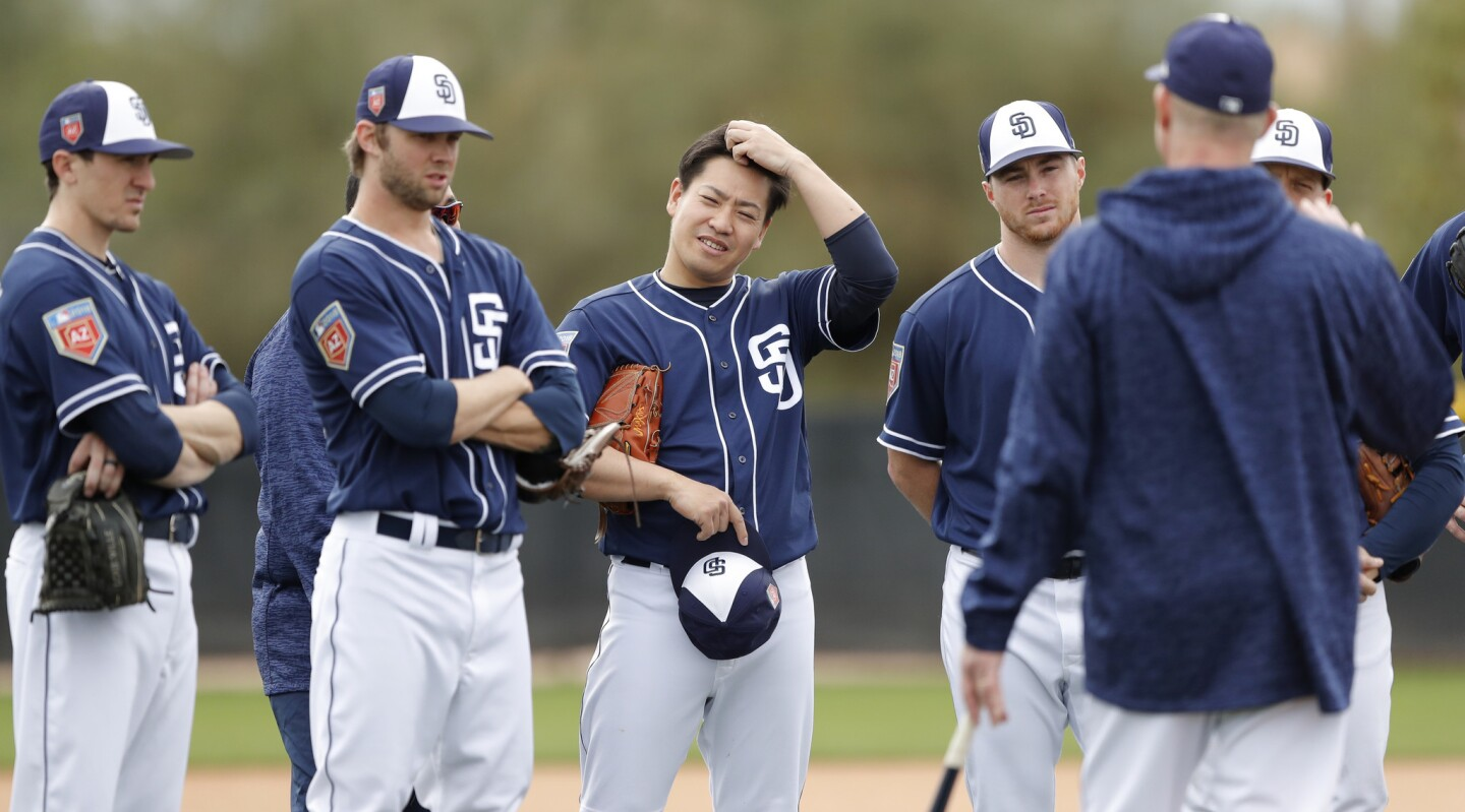 San Diego Padres pitcher Kazuhisa Makita, of Japan, center, participates in a drill during a baseball spring training workout, Friday, Feb. 16, 2018, in Peoria, Ariz. (AP Photo/Charlie Neibergall)
