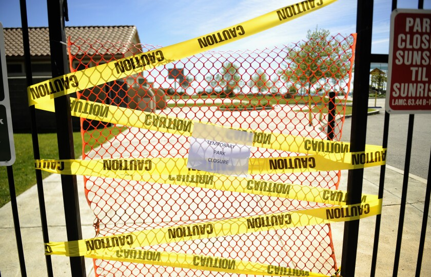 Caution tape keeps residents clear of a park in Porter Ranch as a cleanup from the four-month gas leak continues.