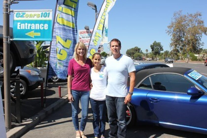 (L-R) Karen Ventura, General Manager Linda Johnson and Gene Ventura. They are in front of EZCars101 on Coast Highway in Encinitas, which the Venturas own.