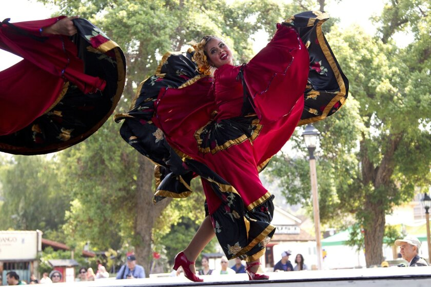 Dancers with the Paso De Oro Dance Company perform on stage during the Cinco de Mayo celebrations at Old Town Park.