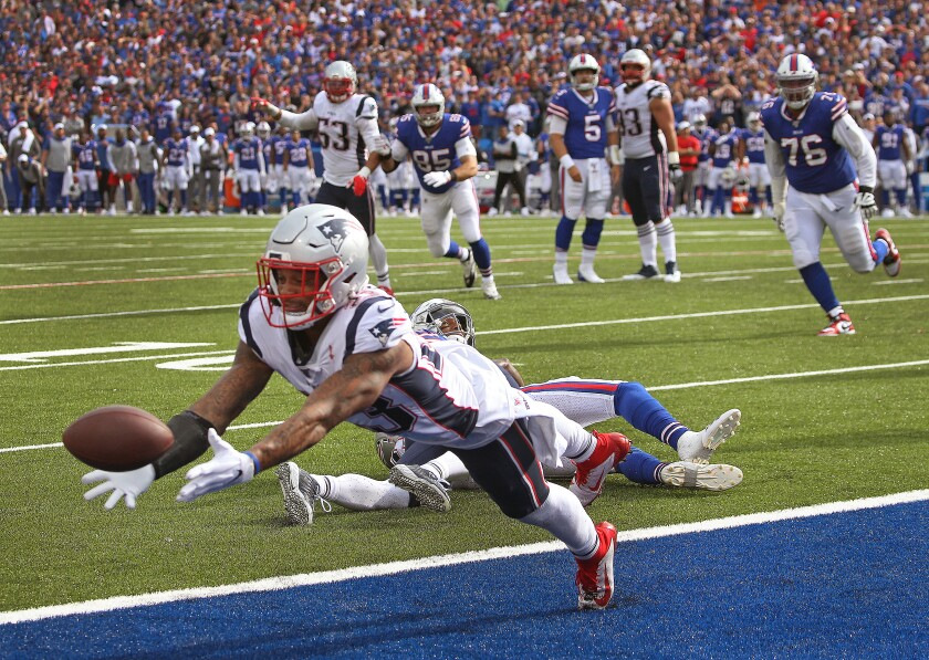 Patriots safety Patrick Chung intercepts a pass in the fourth quarter of Sunday's game against the Bills.