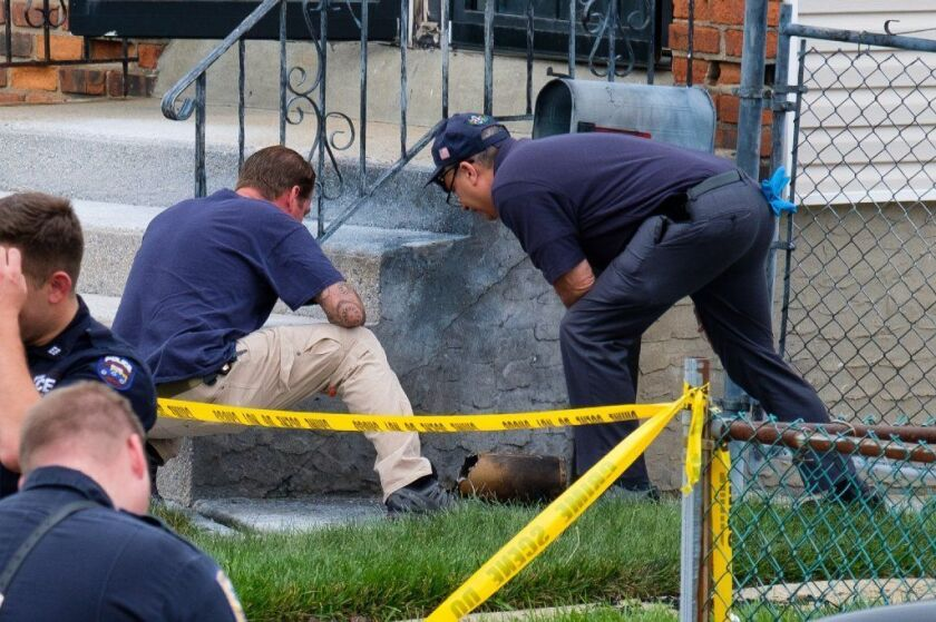 Police investigate a package explosion on 222nd Street in Springfield Gardens, Queens on July 23 2017.