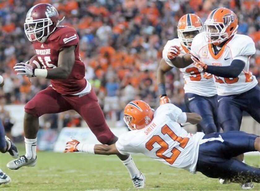 New Mexico State's Germi Morrison runs with the ball in the Aggies defeat to UTEP at Aggie Memorial Stadium on Sept. 14