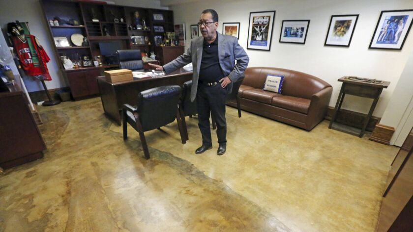 Los Angeles City Council President Herb Wesson shows where carpet has been removed from his office d