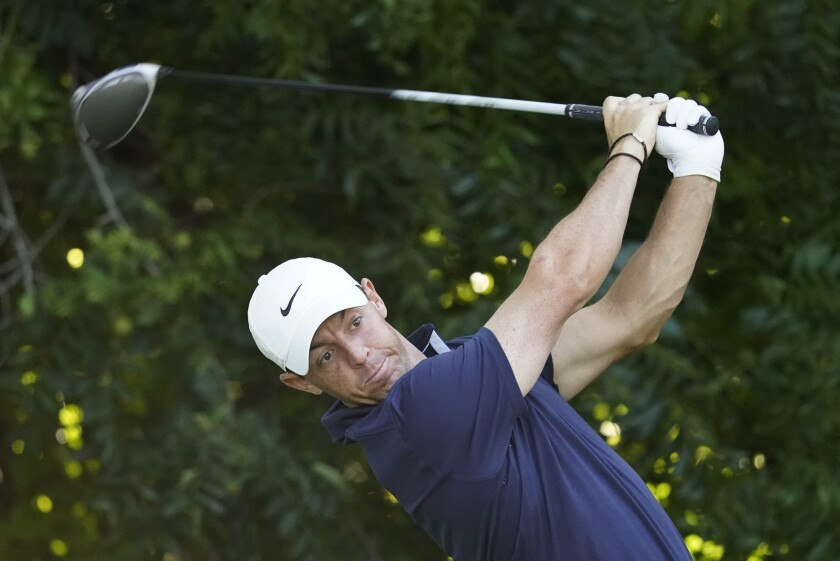Rory McIlroy, of Northern Ireland, tees off on the sixth hole during practice for the Charles Schwab Challenge golf tournament at the Colonial Country Club in Fort Worth, Texas, Wednesday, June 10, 2020. (AP Photo/David J. Phillip)