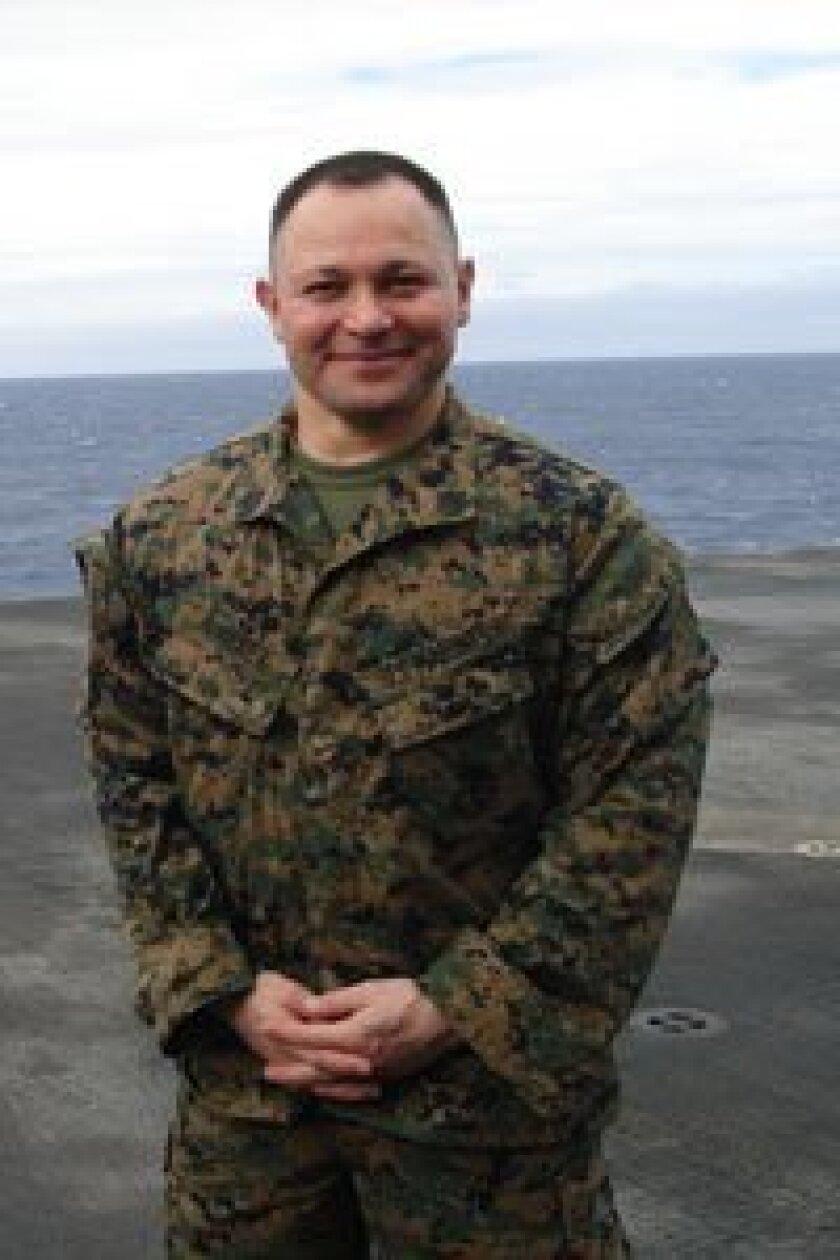 Gunnery Sergeant Joseph Abraham Alvarez on the deck of USS Iwo Jima Photos courtesy of U.S. Marine Corps