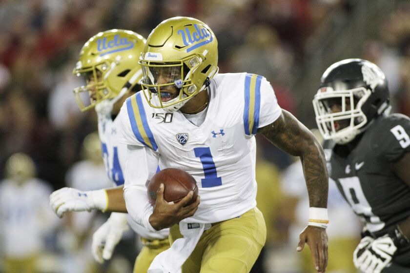 UCLA quarterback Dorian Thompson-Robinson runs with the ball.