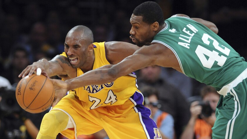 Lakers star Kobe Bryant and Celtics guard Tony Allen battle for a loose ball during Game 6 of the 2010 NBA Finals at Staples Center.