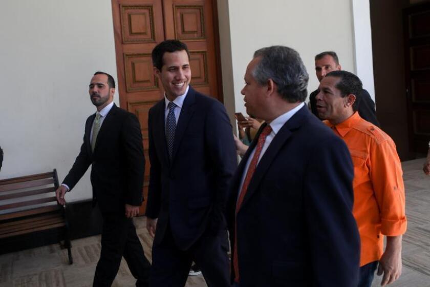 Venezuelan Parliament President Juan Gauido (C) arrives for a session of the National Assembly at the Federal Legislative Palace, in Caracas, Venezuela, 22 January 2019. EFE-EPA/ Cristian Hernandez