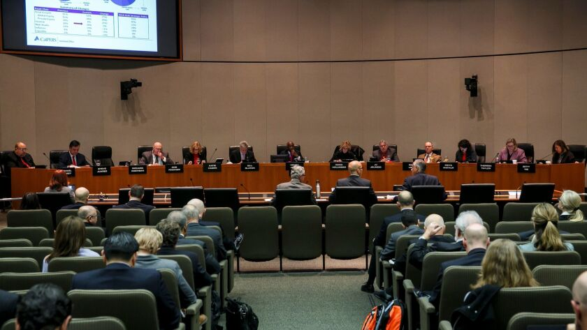 The CalPERS board of administration meets in Sacramento last year. New legislation would add two members, appointed by the governor, to the board.
