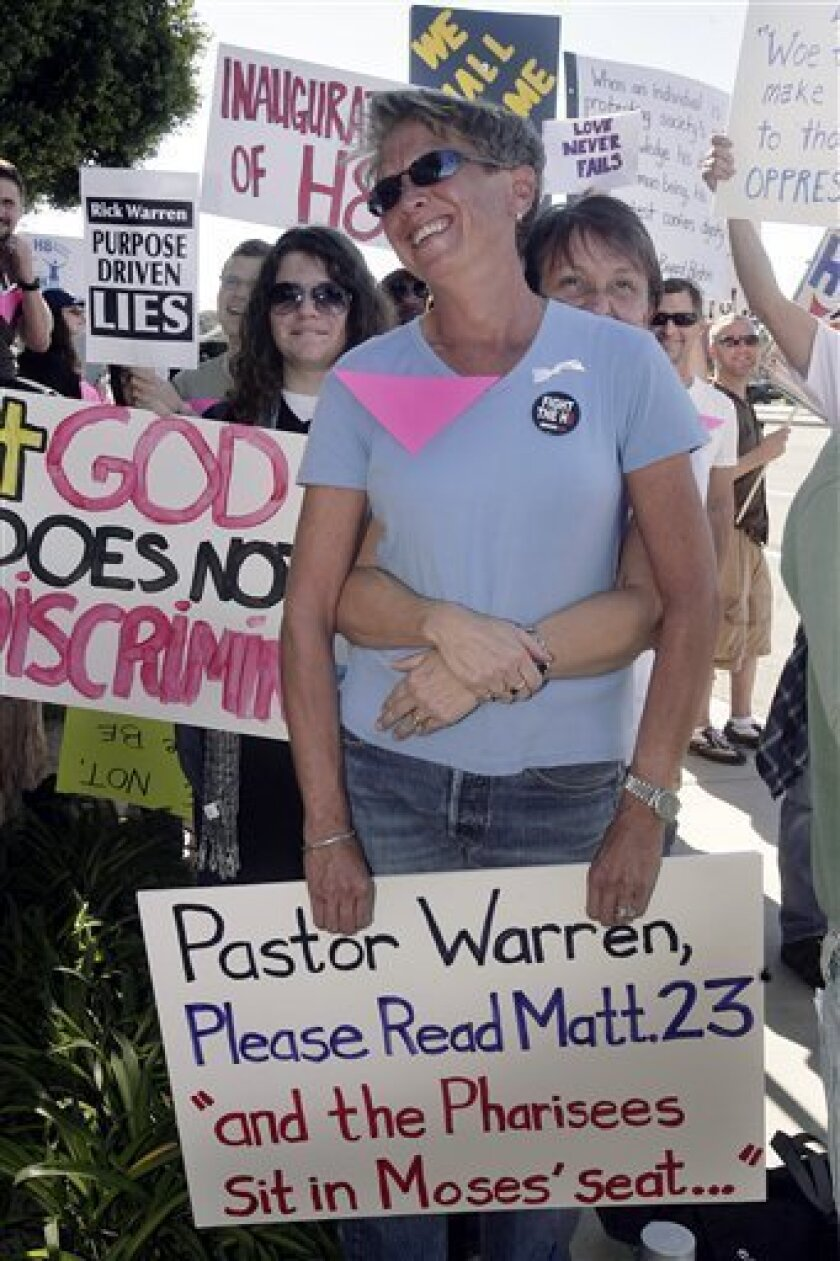 Shelley Kuchta, foreground, and Diane Duke join demonstrators protesting on behalf of gay rights outside of evangelical pastor Rick Warren's Saddleback Church Sunday, Jan. 18, 2009, in Lake Forest, Calif. Warren has been invited by President-elect Barack Obama to deliver the invocation at the presi
