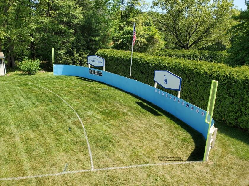 Massachusetts resident Ben Massé has constructed a Wiffle Ball field, designed to resemble Dodger Stadium, in his backyard.