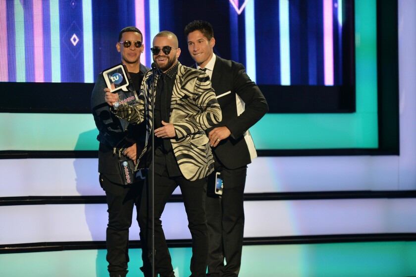 Chino y Nacho and Daddy Yankee accept an award during Telemundo's Premios Tu Mundo show in Miami. Attempts by SAG-AFTRA to run an ad that called for the unionization of performers on Telemundo during the awards show were rebuffed.