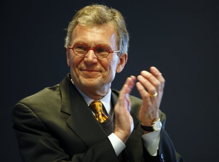 Former U.S. Senate Majority leader Tom Daschle, who is the nominee for health and human services secretary in the Obama administration, applauds before speaking about plans for reforming the country's health care system during the 2008 Colorado Health Care Summit in Denver on Friday, Dec. 5, 2008. The summit capped off a 31-county tour of Colorado by U.S. Sen. Ken Salazar, D-Colo., to discuss the condition of the nation's health care system with elected officials and business owners. (AP Photo/David Zalubowski)