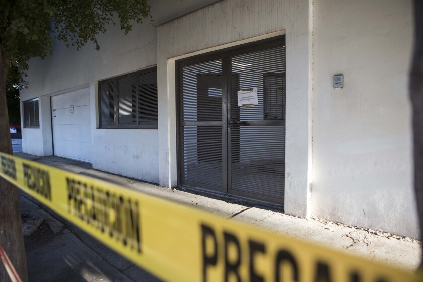 """Police tape surrounds the entrance of the home where marines engaged in a gun battle during the search for Mexican drug lord Joaquin """"El Chapo"""" Guzman, in Los Mochis, Mexico, Sunday, Jan. 10, 2016."""