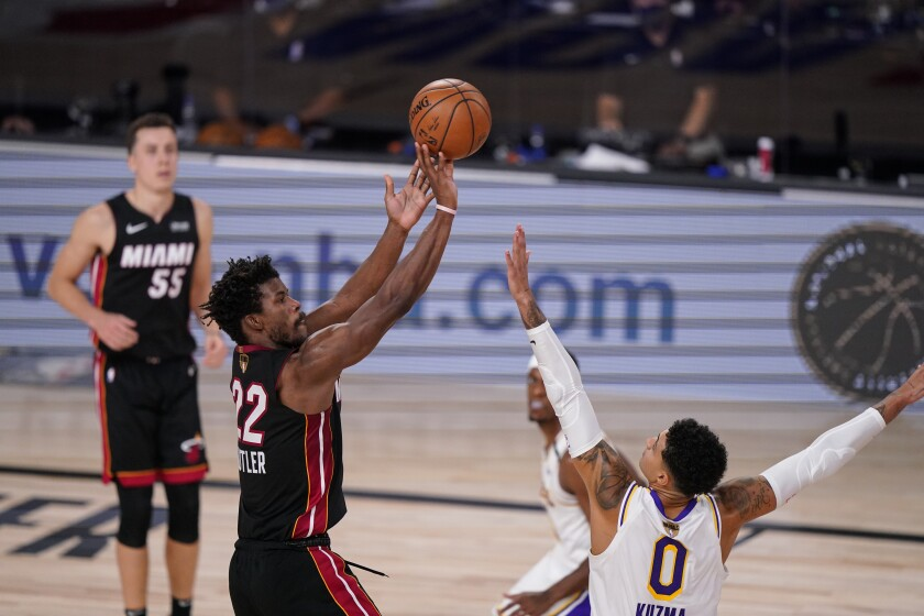 Miami's Jimmy Butler shoots a fadeway jumper against the Lakers during Game 3 of the NBA Finals on Sunday.
