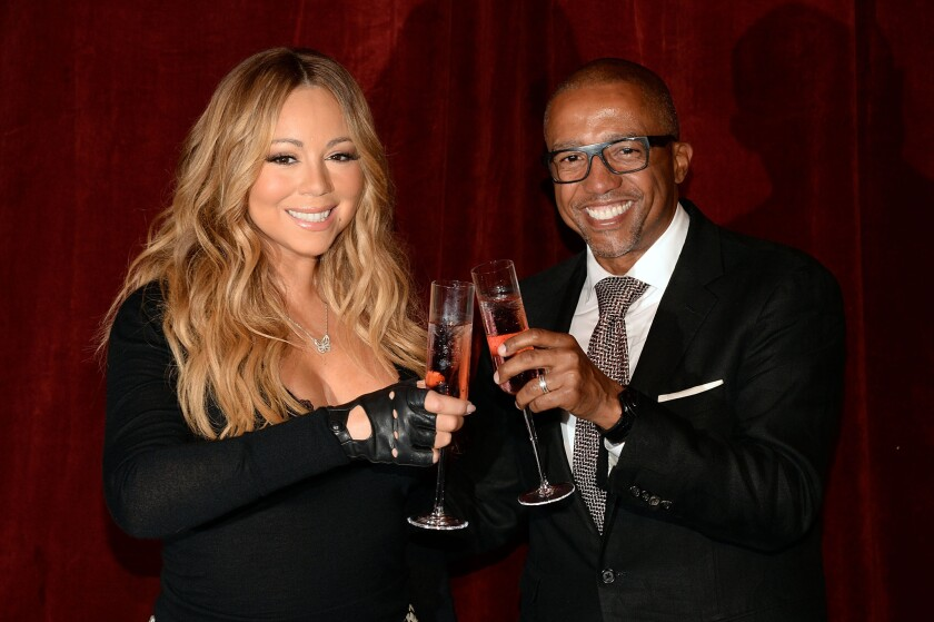 Singer Mariah Carey and business partner Kevin Liles, CEO of Go N'Syde beverages, announce the launch of her new beverage Butterfly in New York on Monday.