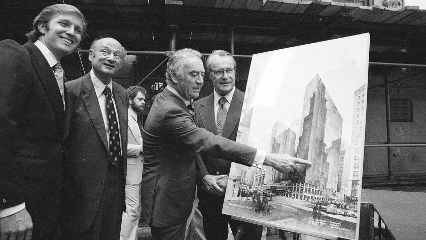 Fred Trump points to an artists' conception of the Grand Hyatt New York hotel in June 1978. At far left is son Donald Trump next to then-New York Mayor Ed Koch.