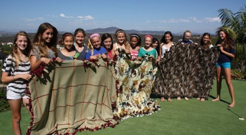 Members of FAV (Female Athlete Volunteers), a Teen Korps chapter, spent a recent Sunday supporting Soldier's Angels and made Blankets of Hope to be sent overseas to wounded troops and veterans.