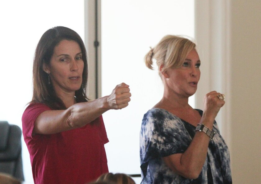 Andrea Dahlberg and Sherry Ahern tout a fundraising brew fest and masskrugstemmen (beer stein holding contest) new to this year's La Jolla Art and Wine Festival, Oct. 11-12. Proceeds will benefit pediatric brain cancer research.  LaJollaArtAndWineFestival.org