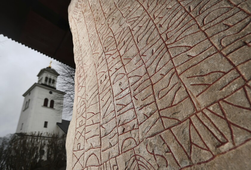 A Viking-era runic stone in front of the Rok Church near the Lake Vattern and the town of Odeshog, Sweden, Thursday Jan. 9, 2020. The stone dated to the 9th century could have been raised out of fear of a climate disaster, says a new study. (Jeppe Gustafsson/TT via AP)