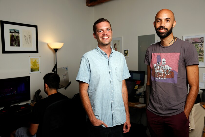"""""""Post-'Oxenfree,' we thought, 'Why not do some crazy world-building?'"""" said Sean Krankel, right, with Adam Hines."""