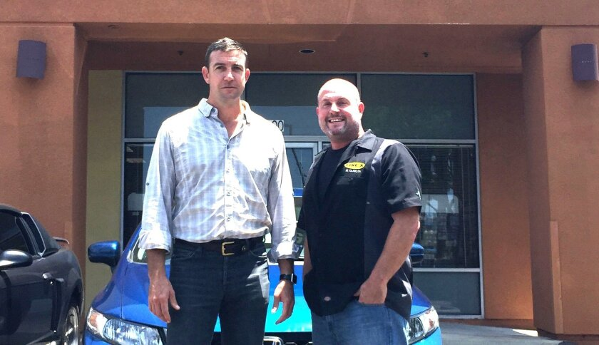 Congressman Duncan Hunter, left, stands in front of the U.S. Army recruitment center that neighbors his El Cajon office. With him is Patrick Conway, U.S. Army veteran and owner of a business in the same complex. Conway supports Hunter's efforts to allow recruitment centers to be armed.