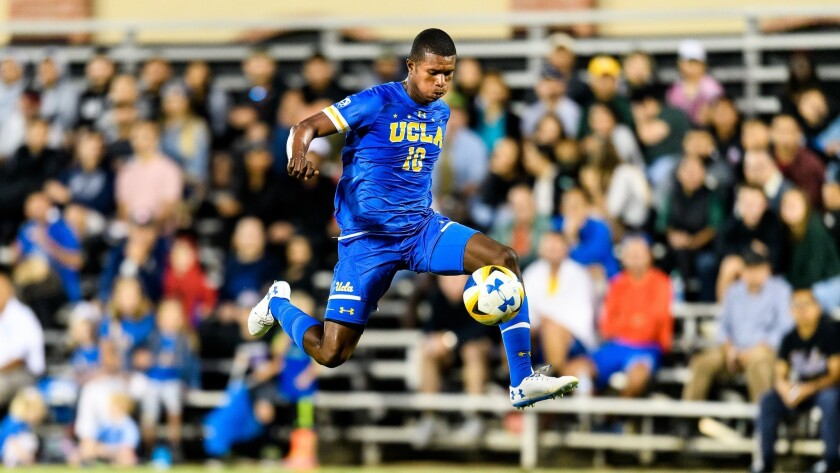 Mohammed Kamara takes the ball down the field during a UCLA soccer game on Sept. 2, 2018.