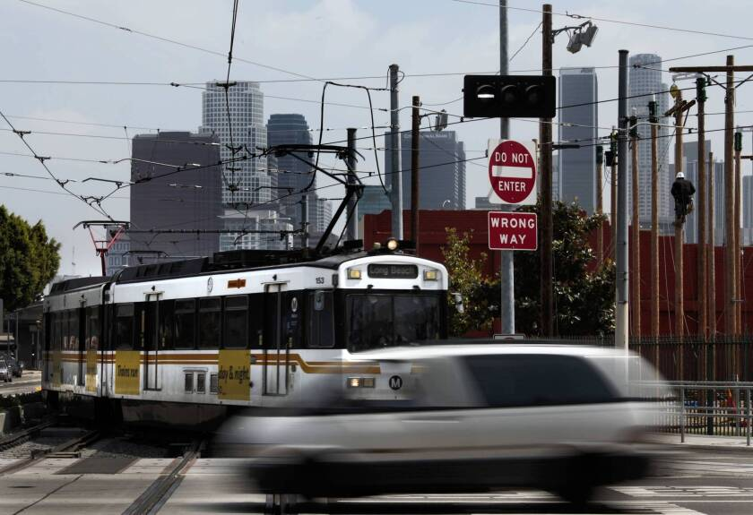 The junction at Washington Boulevard and Flower Street, where the Blue and Expo light rail lines merge just south of downtown Los Angeles, will be examined by Metro's inspector general.