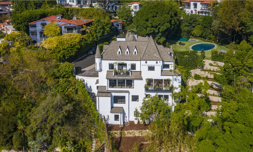 Built in 1926, the French Normandy-style home features turrets on the outside and modern, minimalist spaces on the inside.