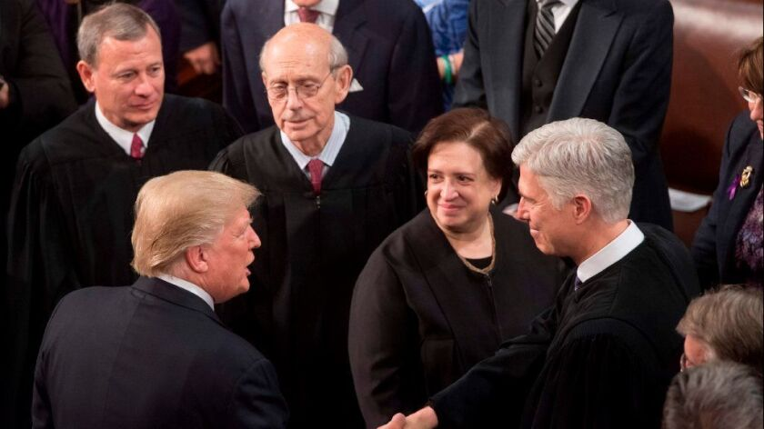 President Trump shakes hands with Justice Neil Gorsuch, alongside Chief Justice John G. Roberts Jr. and Justices Stephen Breyer and Elena Kagan, during the State of the Union Address in January.