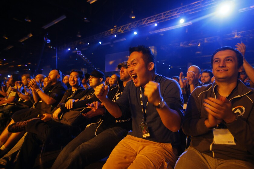Video game fans show their enthusiasm at Blizzard Entertainment's annual fan convention and gaming tournament in November.