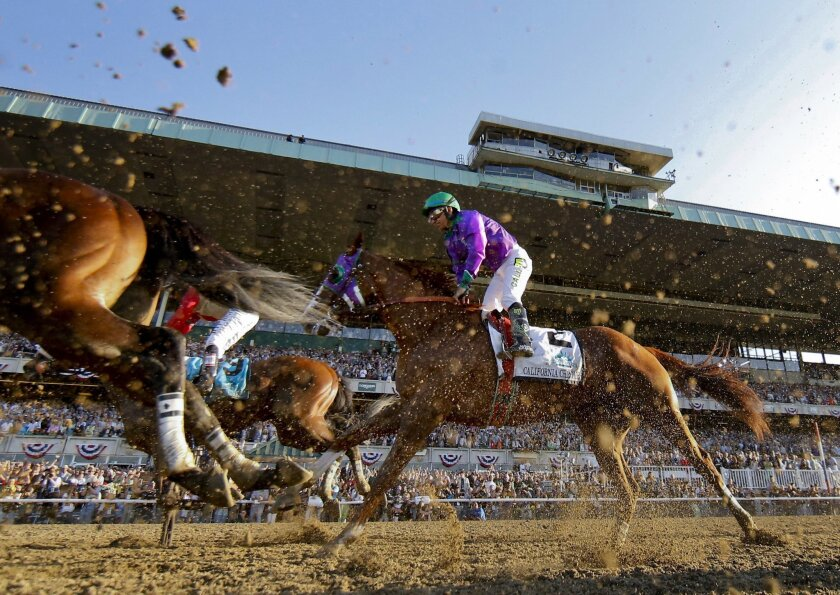 California Chrome with Victor Espinoza up finishes fourth in the Belmont Stakes horse race, Saturday, June 7, 2014, in Elmont, N.Y. (AP Photo/Matt Slocum)