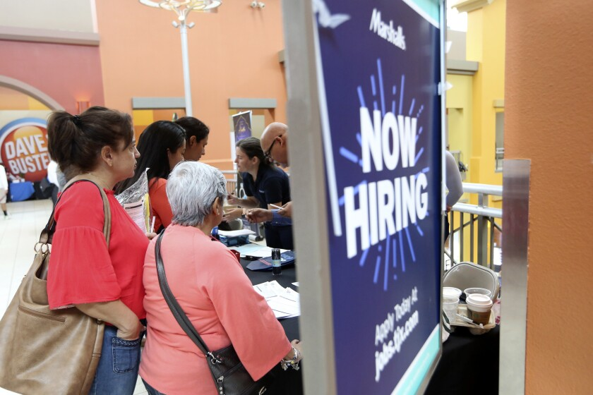People wait to inquire about job openings with Marshalls in Miami