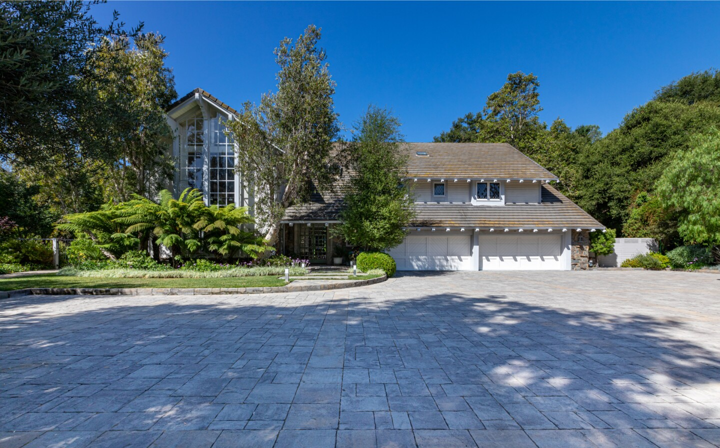 The 1.3-acre estate includes a five-bedroom home, tennis court, swimming pool and spa.