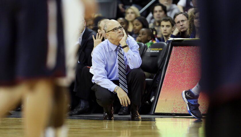 Fairleigh Dickinson head coach Greg Herenda watches his team during the second half of an NCAA college basketball game against Iowa, Monday, Dec. 9, 2013, in Iowa City, Iowa. Iowa won 92-59. (AP Photo/Charlie Neibergall)