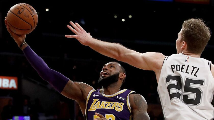 LOS ANGELES, CALIF. - DEC. 5, 2018. Lakers forward LeBron James spins and scores against Suprs nig